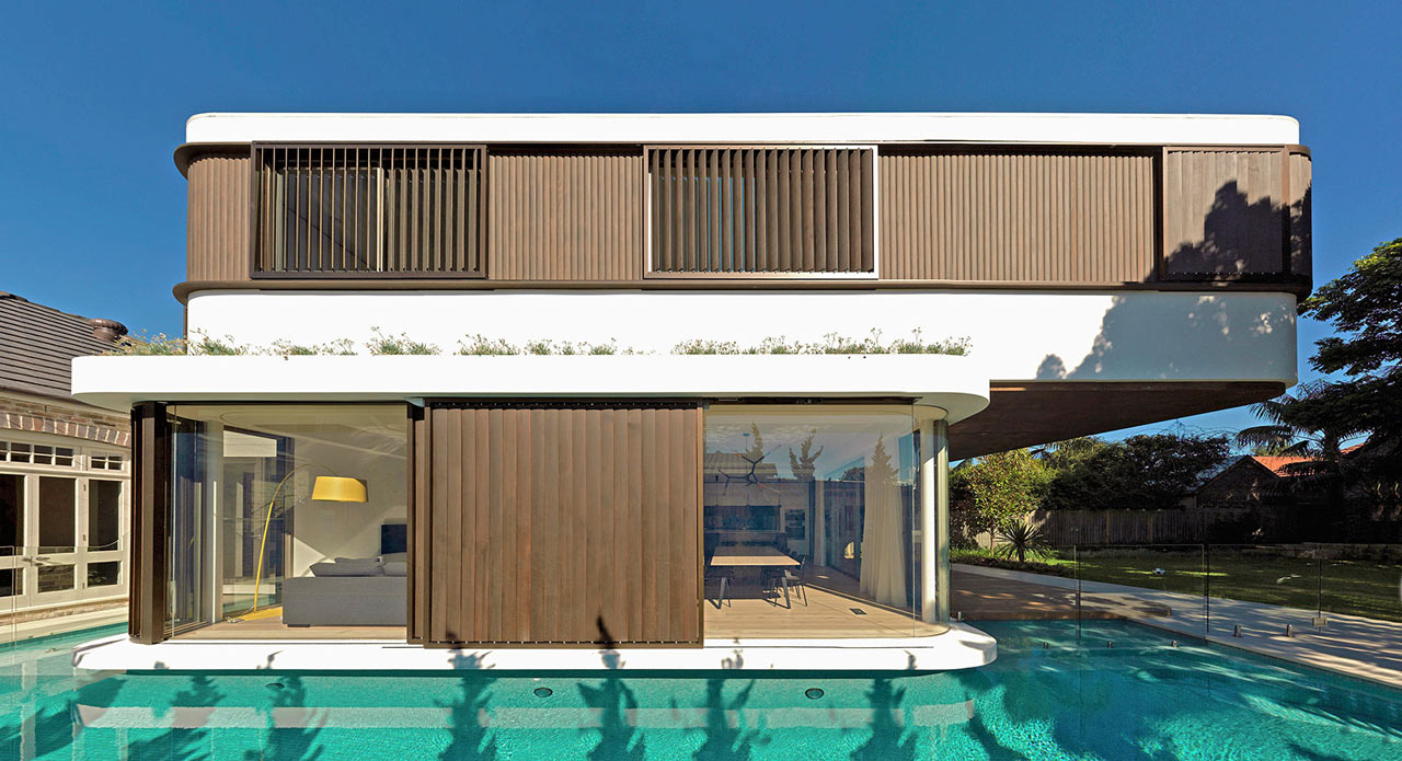 a modern house with a wraparound swimming pool - Swim Pool Designs