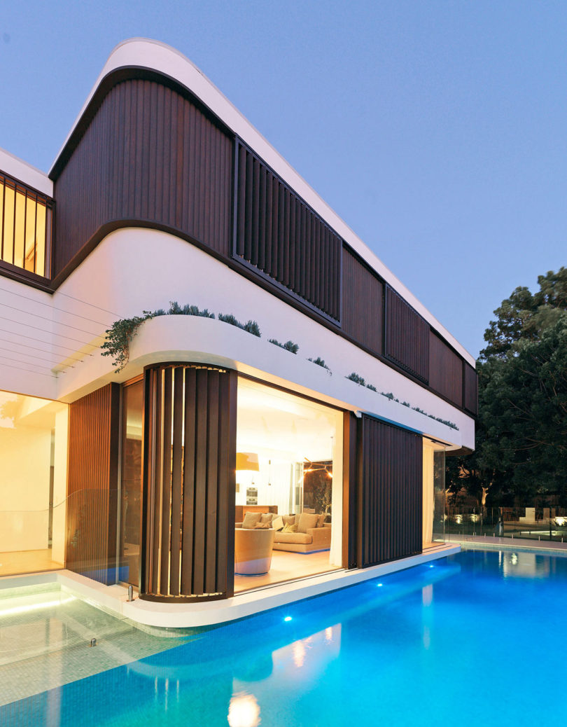 A Modern House with a Wraparound Swimming Pool - Design Milk