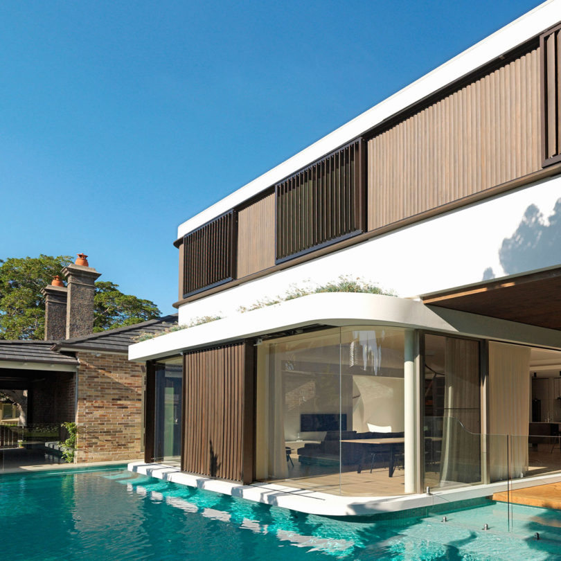 Masion With Swimming Pool: A Modern House With A Wraparound Swimming Pool
