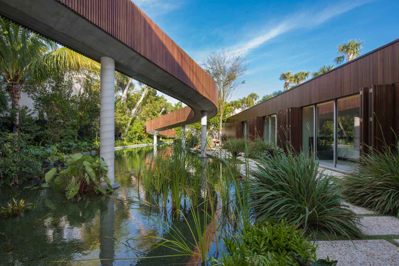 A miami beach home with a swimmable lagoon design milk for Architect florida