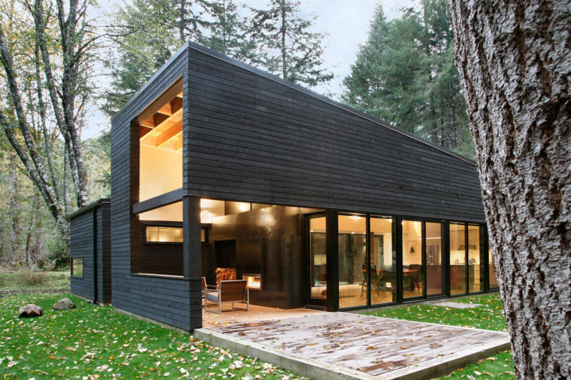 Spanning 1,900 Square Feet, The House Sits Within A Forest Right On The  Banks Of The White River, Blending In With Its Wooded Surroundings.