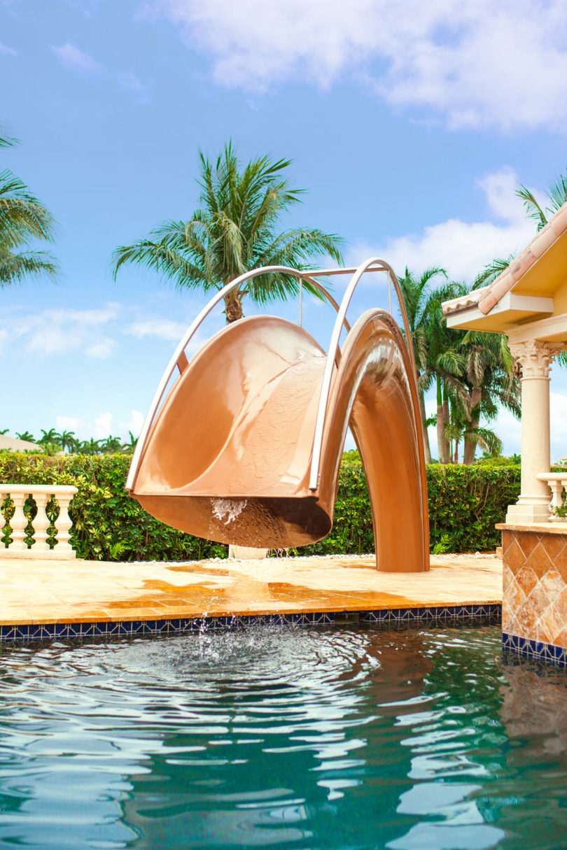 Sleek sculptural water slides for the modern pool for Water pool design