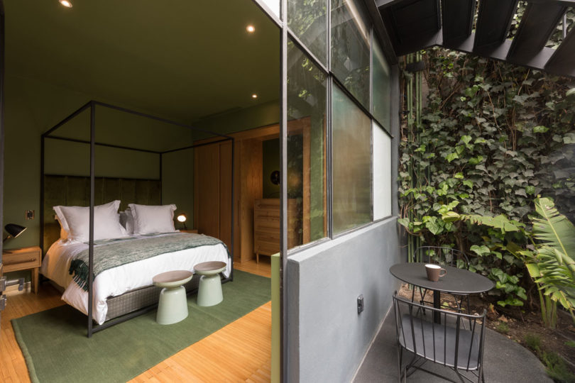guest house interior design. A Glass Enclosed Walkway Connects The Main House To Guest With An  Exterior Wall Of Plants On One Side And A Terrace View Other 1913 Mexico City Mansion Renovation Modern Guest House