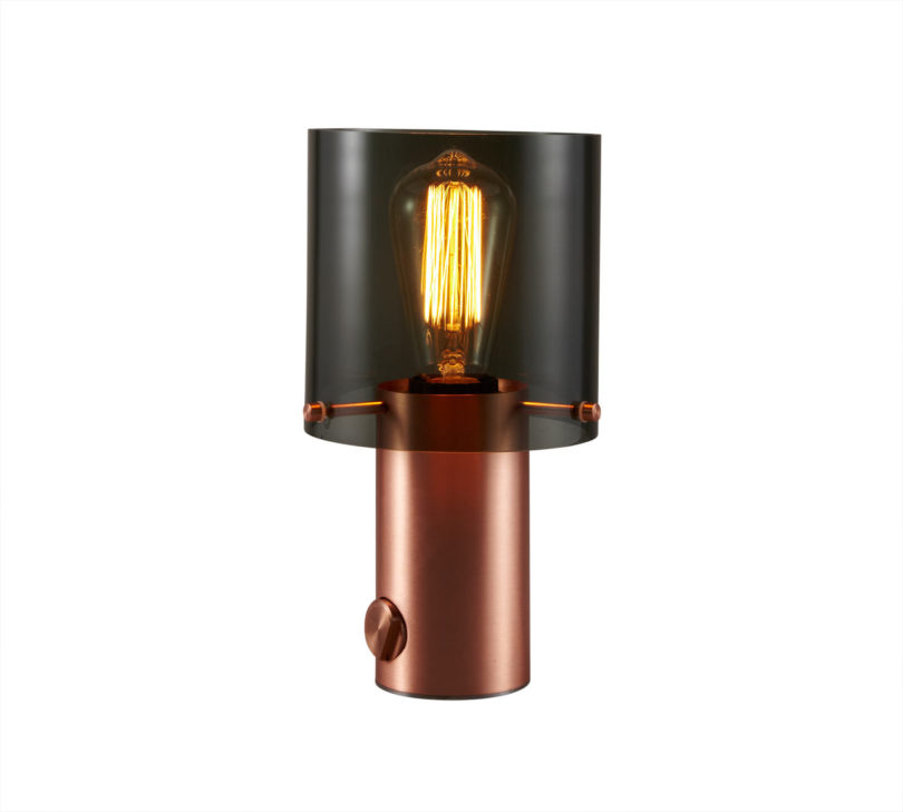 Amazing  brass or satin copper finished base and a choice of either an opal or anthracite glass shade The pieces are topped off with an integrated dimmer at the