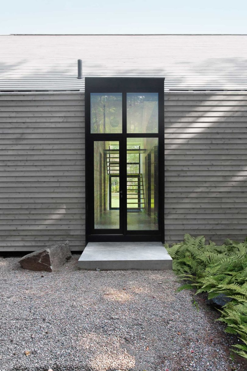 Both The Roof And The Sides Of The House Are Clad In White Cedar Boards For  A Minimalist Look. Along The Sides, Three Tall Windows Keep The Interior  Filled ...