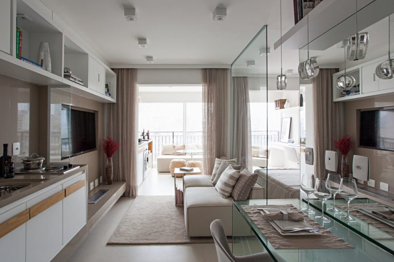 A Neutral Color Palette and Glass Elements Transform a Compact 35m2 Apartment