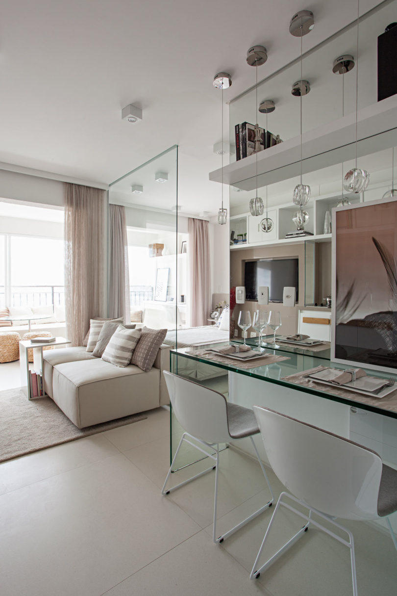 A neutral color palette and glass elements transform a for 35m2 apartment design