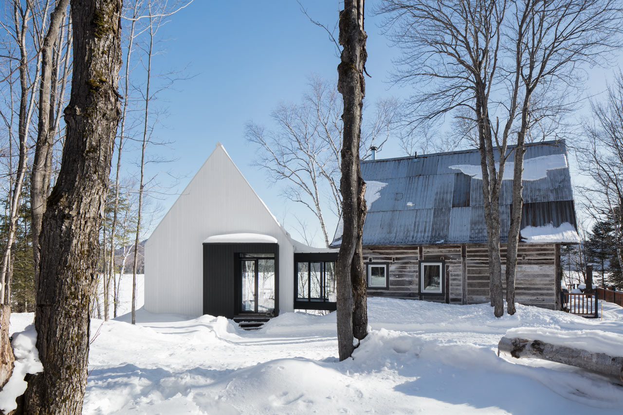 ACDF Architecture Designs a Modern, Prism-Like Addition for Traditional House in Canada