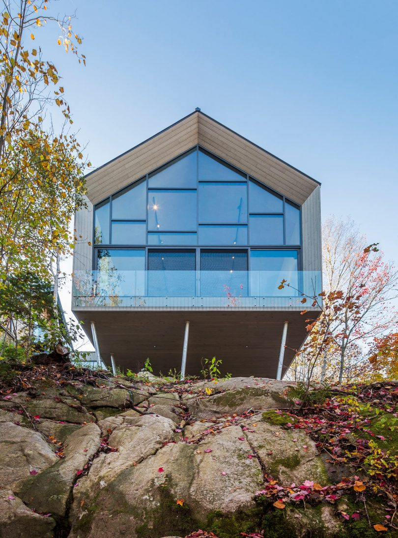 This Workshop on a Cliff Is a Modern Addition to a House Overlooking a Lake