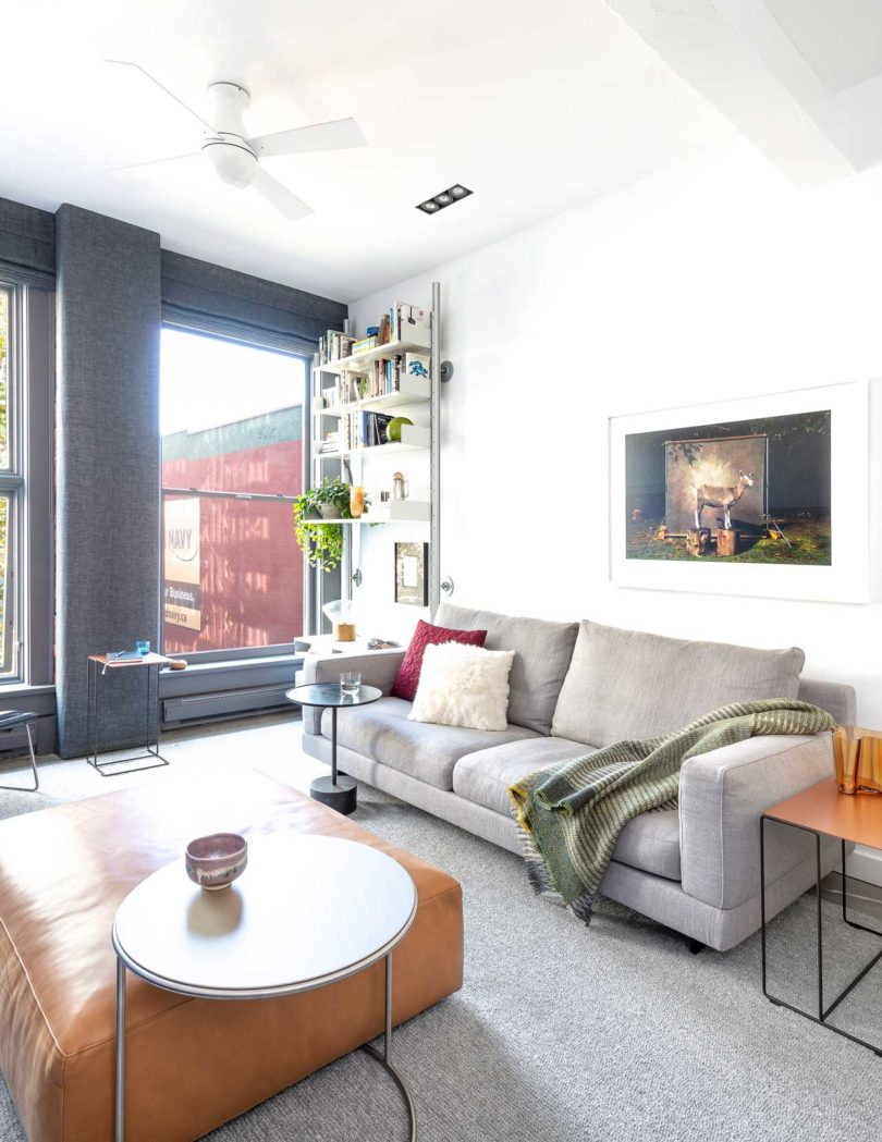 White Walls And Two Large Windows Help Bounce Light Around The Interior  Making It Feel Open.