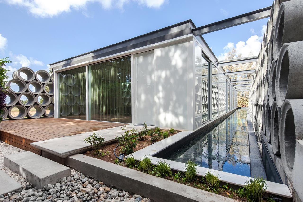 Varda Studio Stacks Concrete Tube Pipes for the AB House in Cyprus