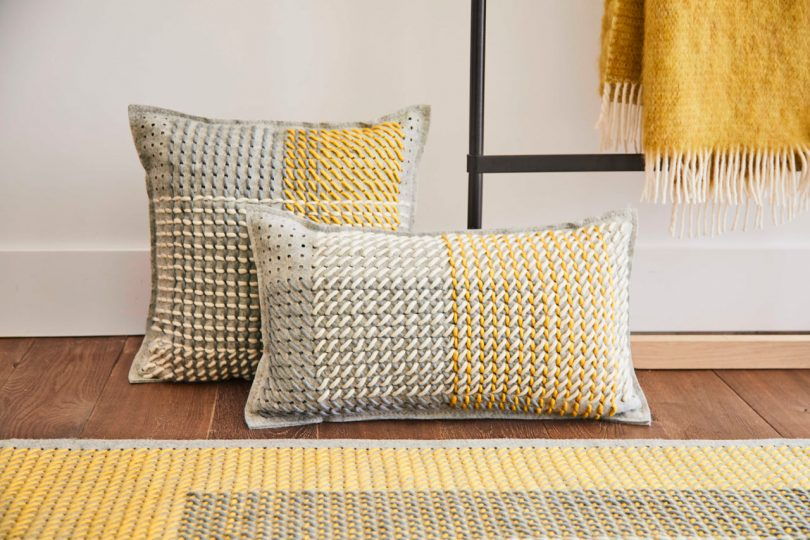 CANEVAS GEO Adds Oversized Cross-Stitching to Rugs and Pillows