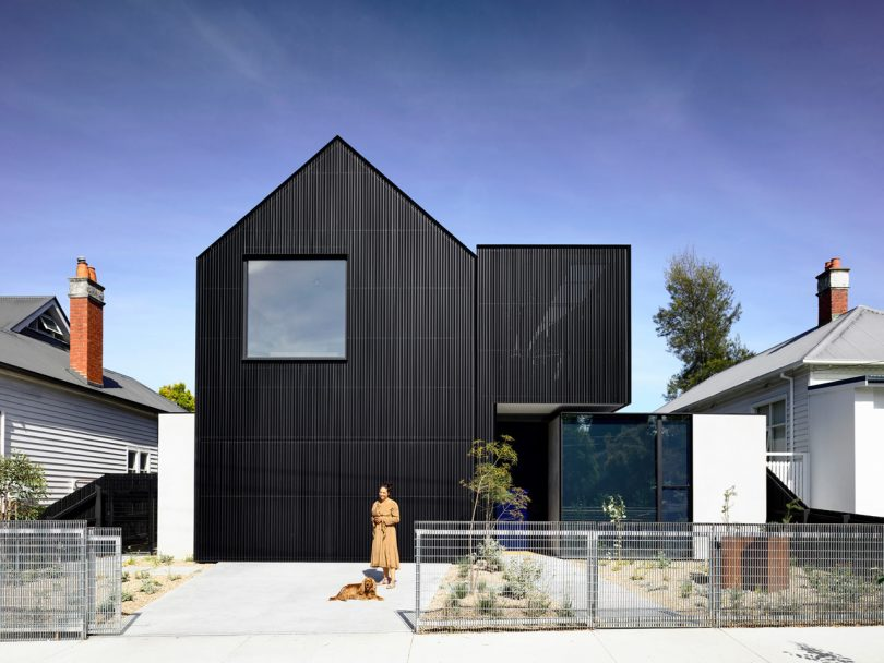 Ola Studio Designs a Black, Sculptural Residence Flanked by White Homes