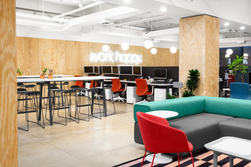 poppin applies their slogan work happy to their nyc headquarters rh design milk com