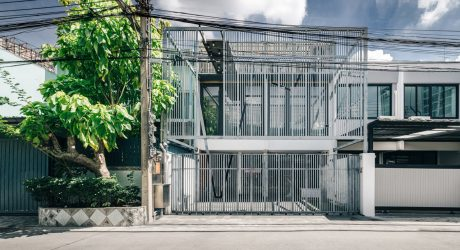 Two Bangkok Townhouses Become One With a Cage-Like Fence for Privacy