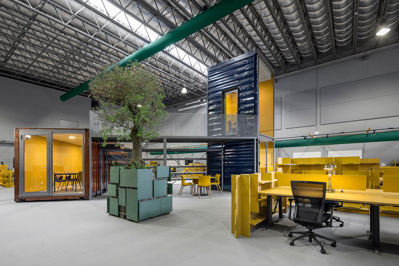 A Warehouse Is Transformed with Shipping Containers into Innovative Office