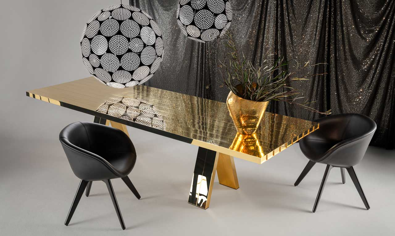 Tom Dixon Turns a Dining Table into a Solid Brass Sculpture