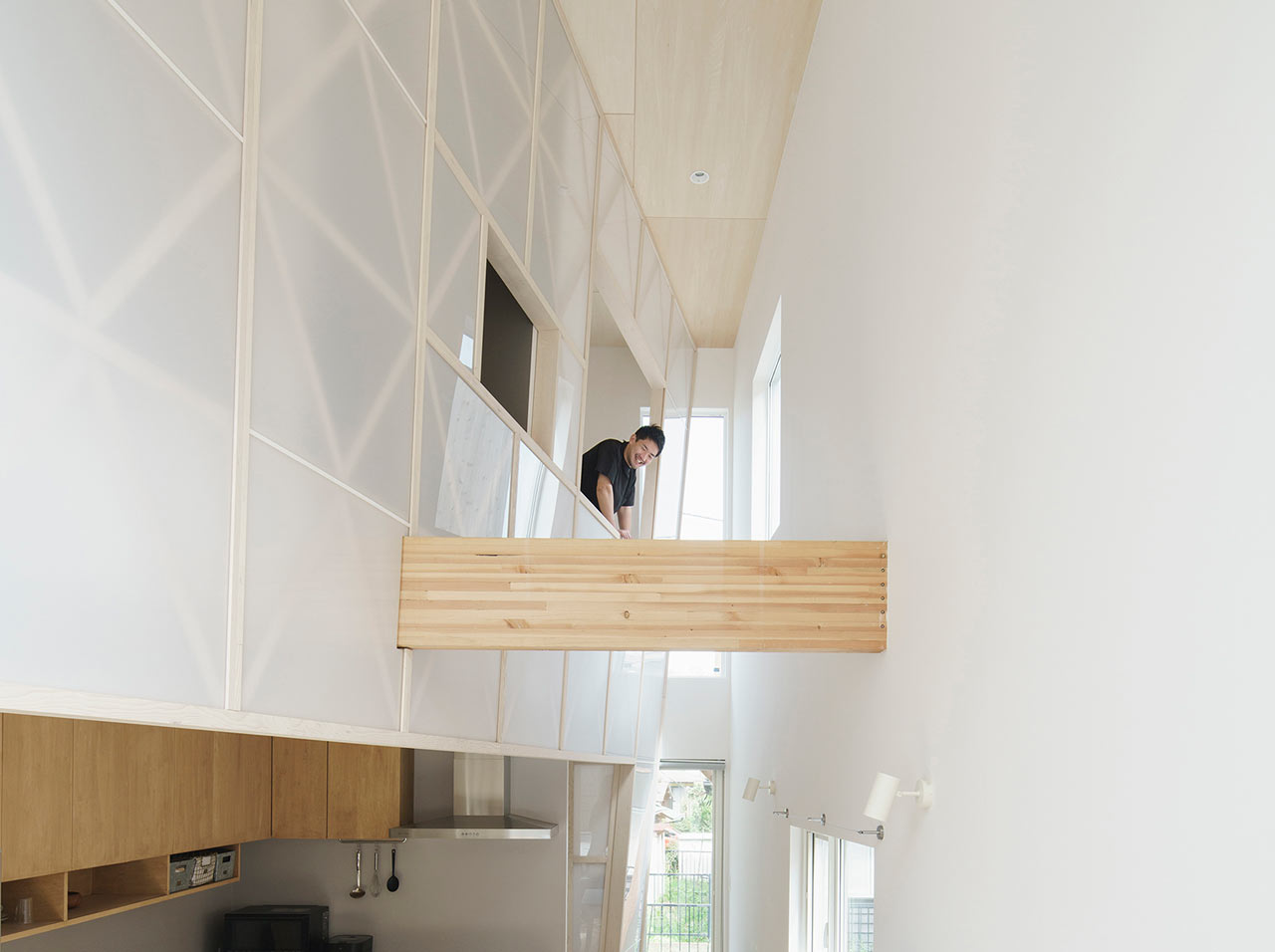 A Small Wooden House in Hayama with an Acrylic Gridded 'Curtain'