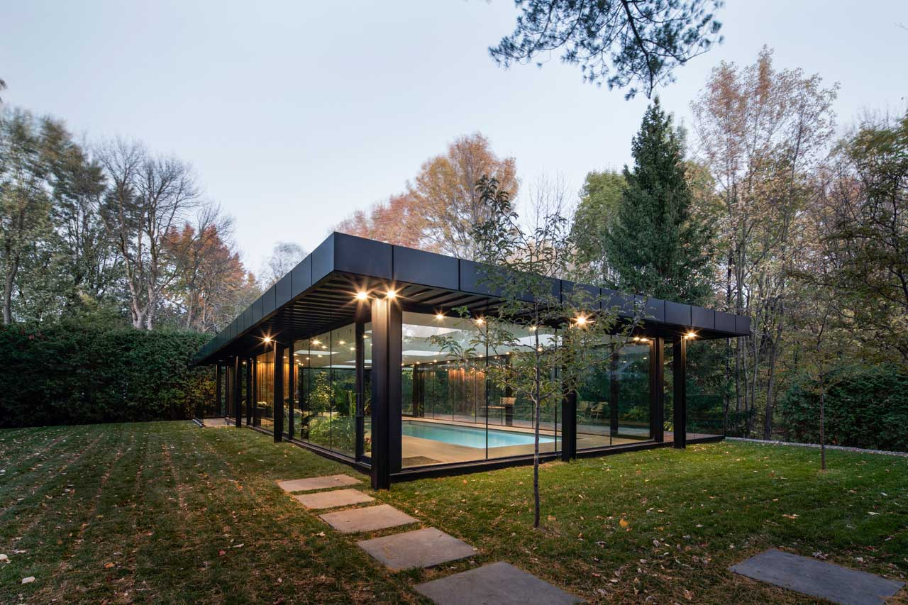 A Glass House Inspired Pavilion For An Indoor Swimming Pool