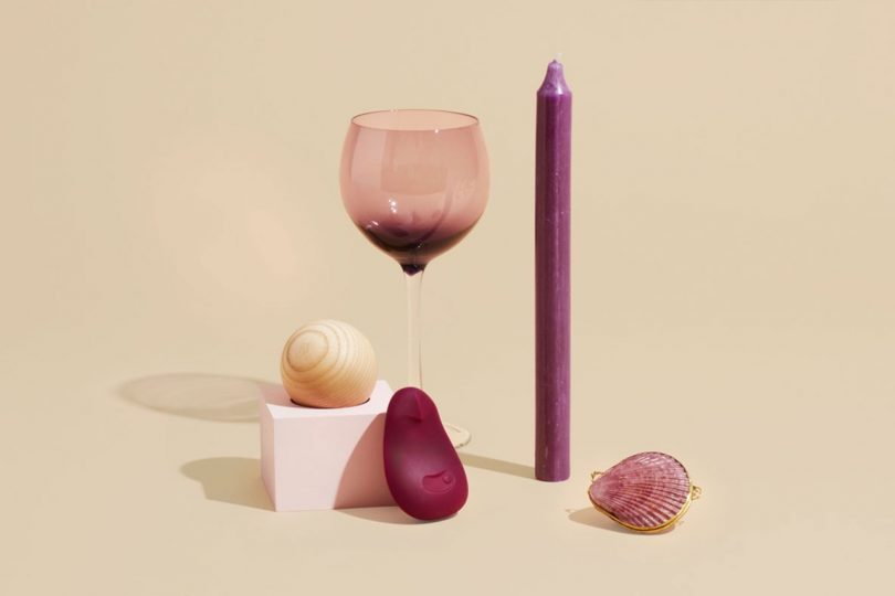 Dame vibrator, wine glass, and candle