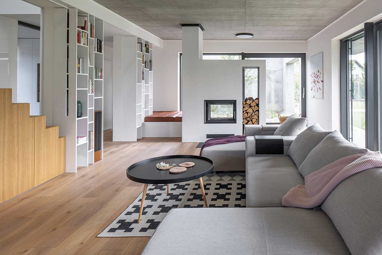 A Family Home in Prague Finished with Concrete, Wood, + Playful Details