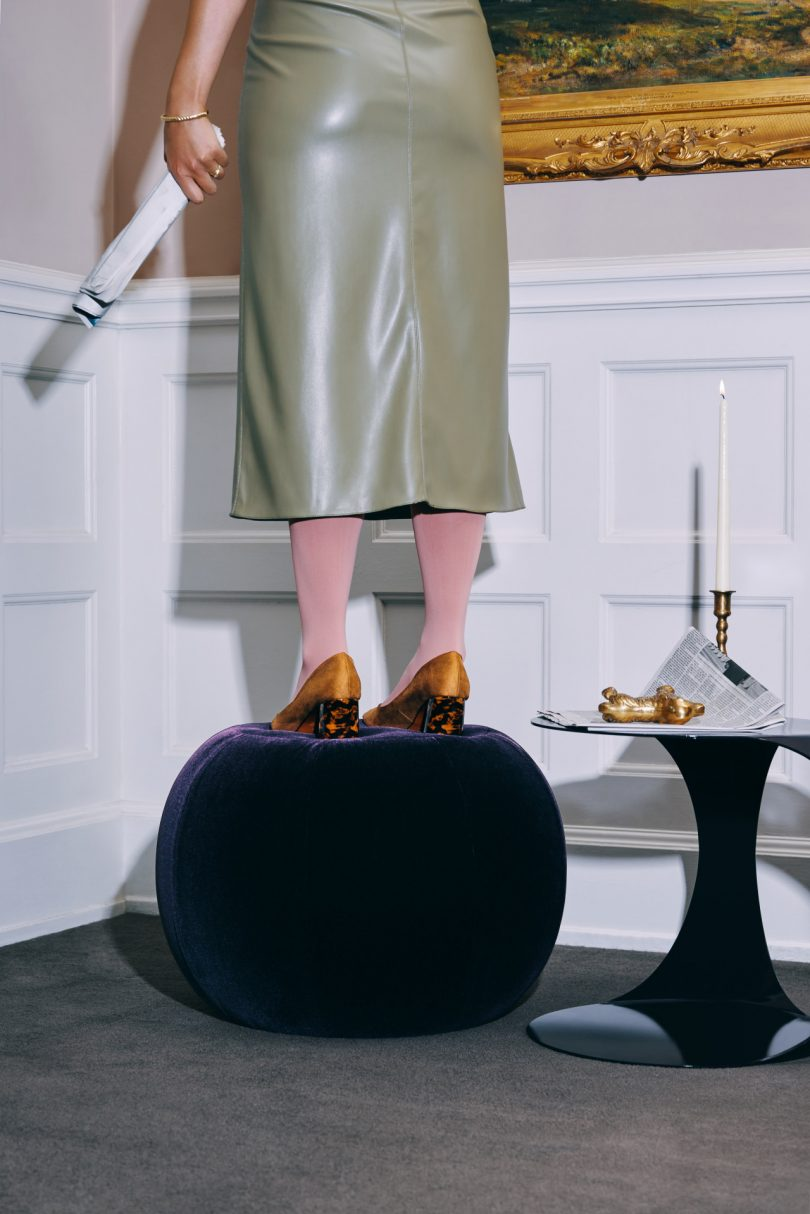 Woman standing on Toof ottoman
