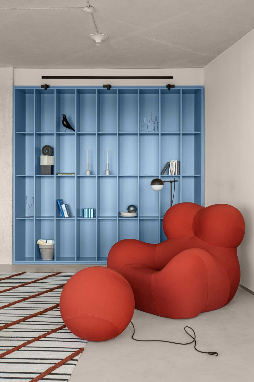 Curved red chair and bookshelf