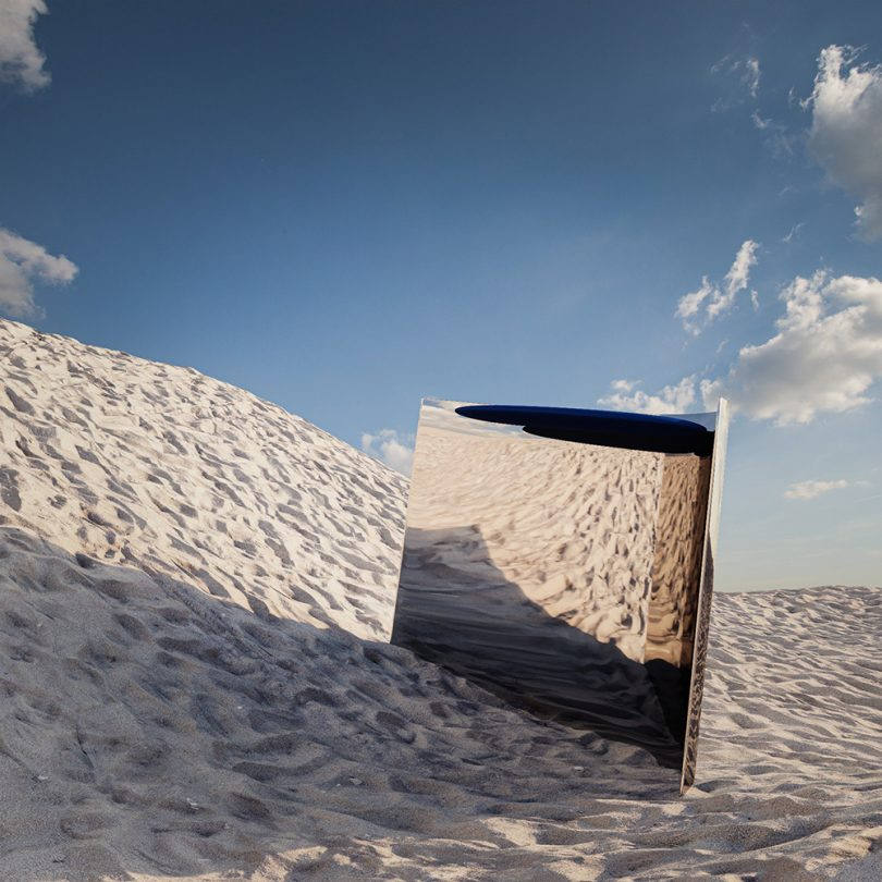 metallic object in a sand dune