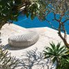 outdoor bench by pool