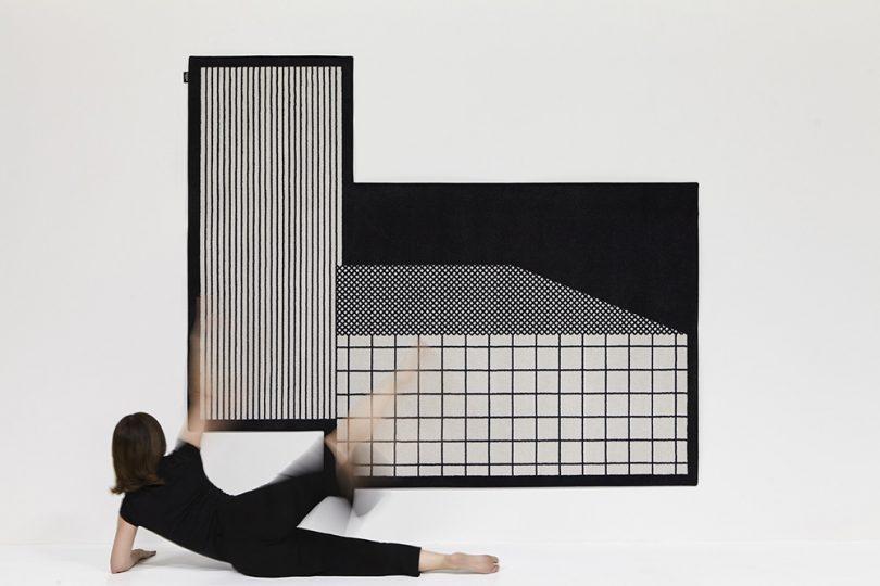 abstract rug hanging on wall