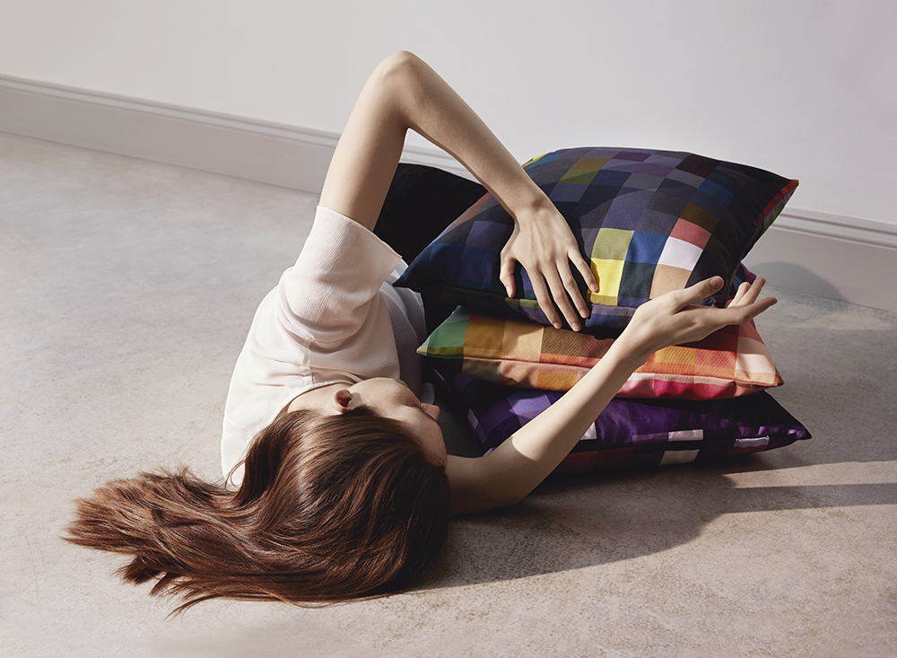 woman on floor with pillows