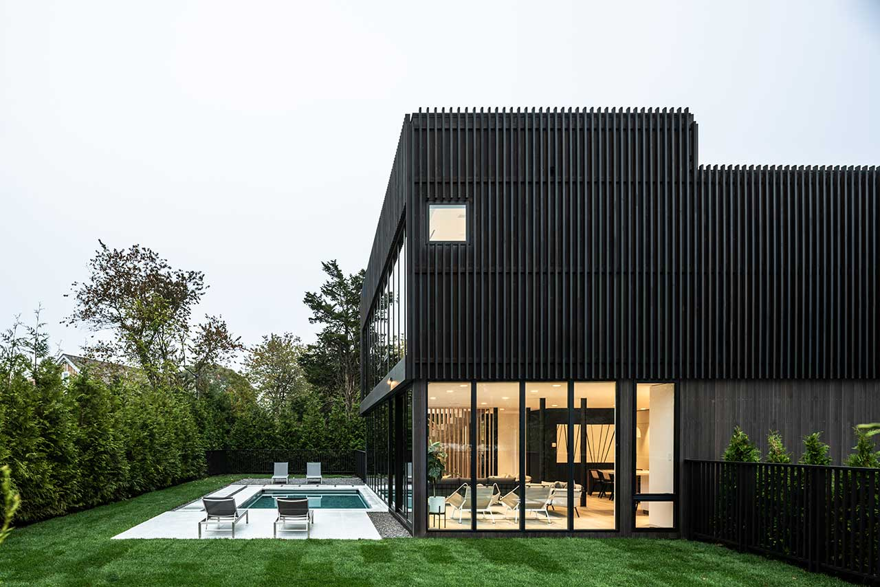 A Sag Harbor Hideaway With Black Slats Creating Privacy + Shade Screens