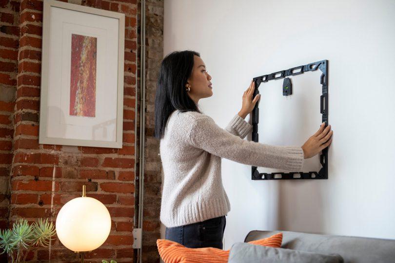 woman installing art