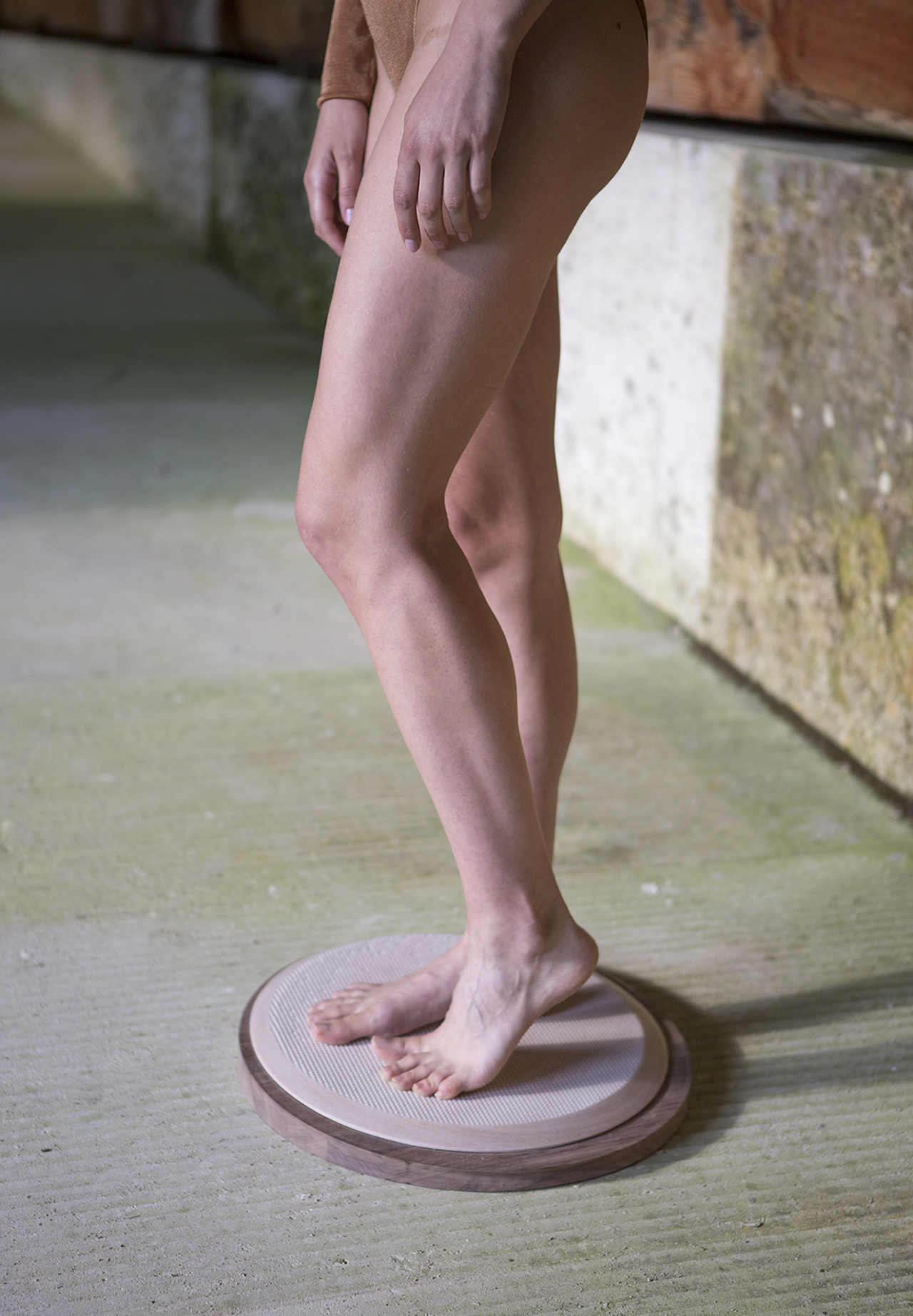 legs standing on round object