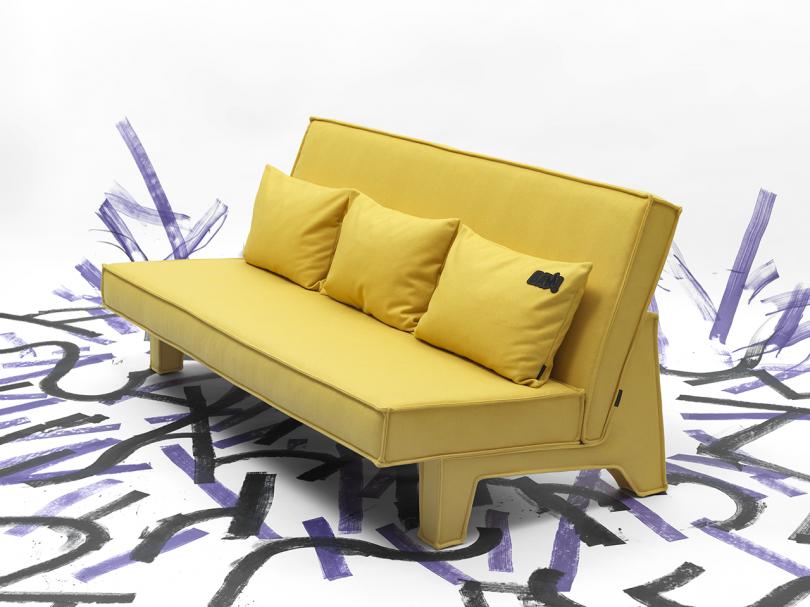 yellow three seat sofa