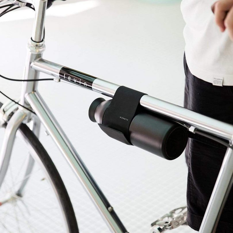 water bottle strapped to bicycle