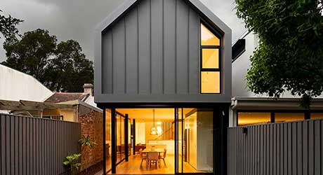 A Crumbling Cottage Becomes New With a Gabled Volume in Back