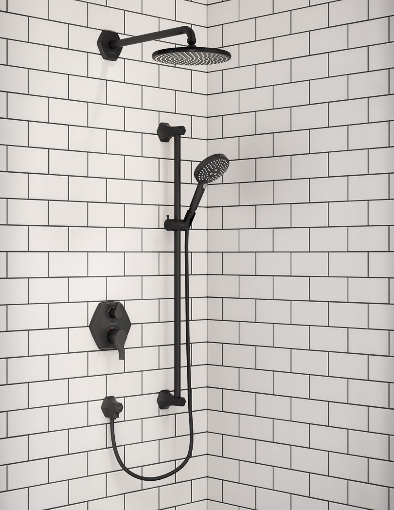 tiled shower with black fixtures