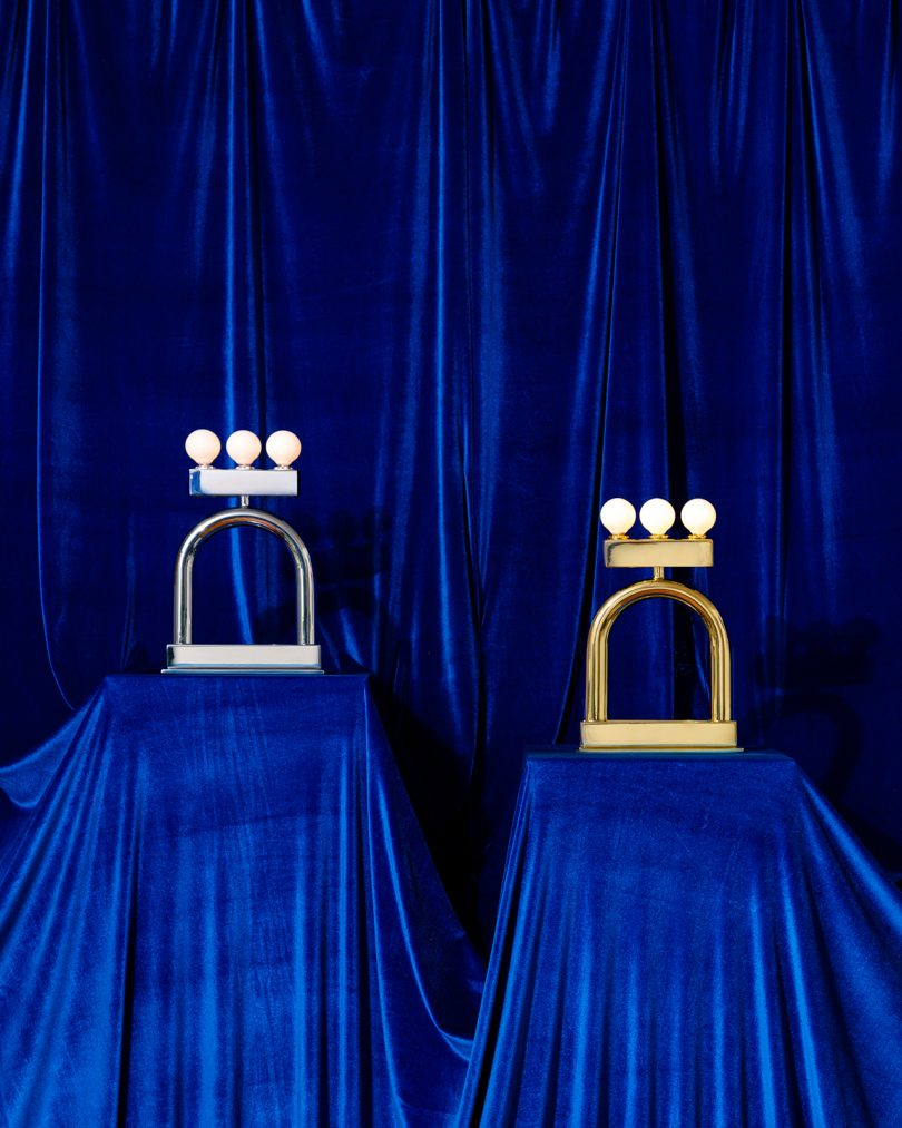 two lamps on blue backdrop
