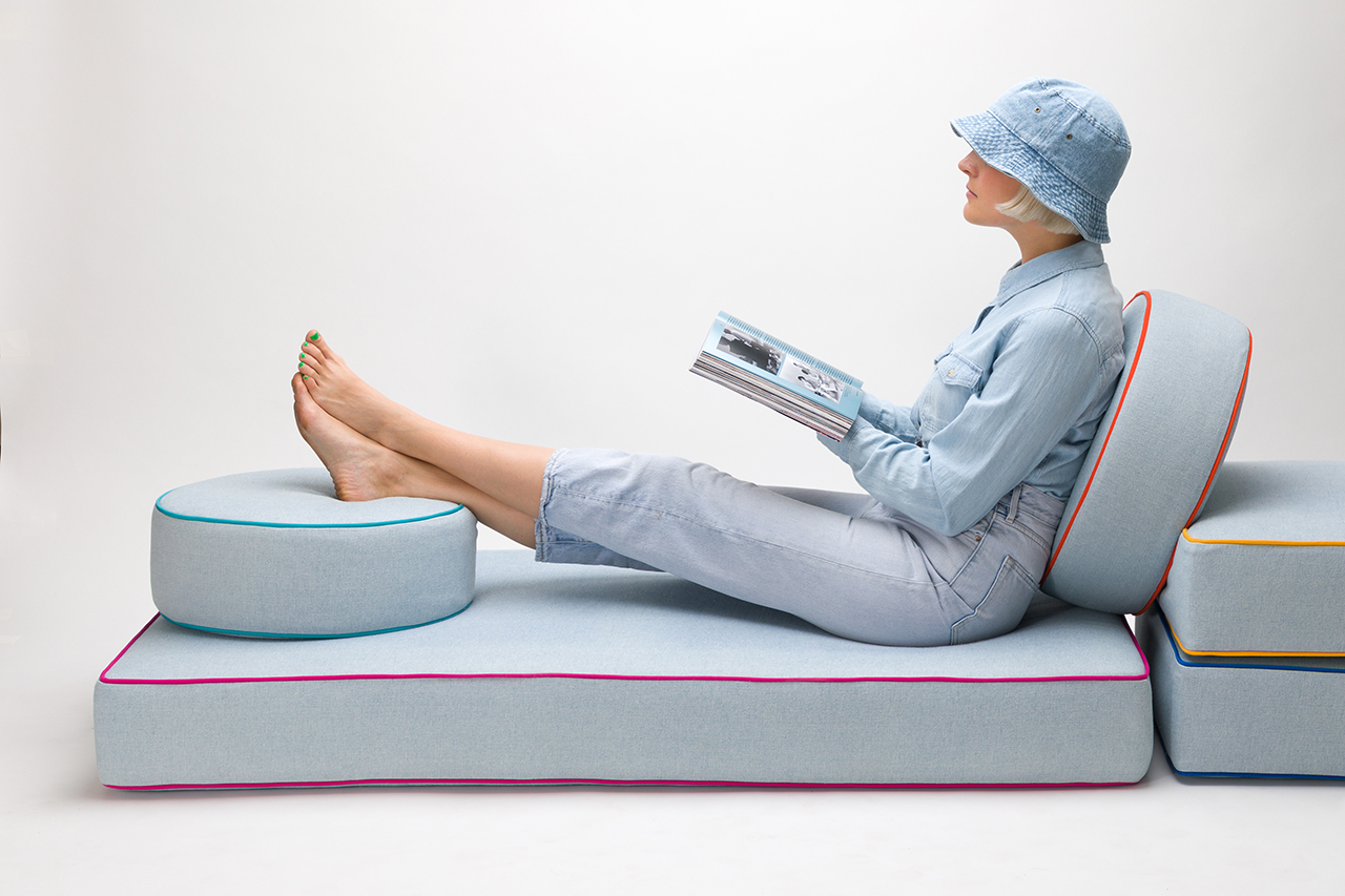 woman lounging on cushions