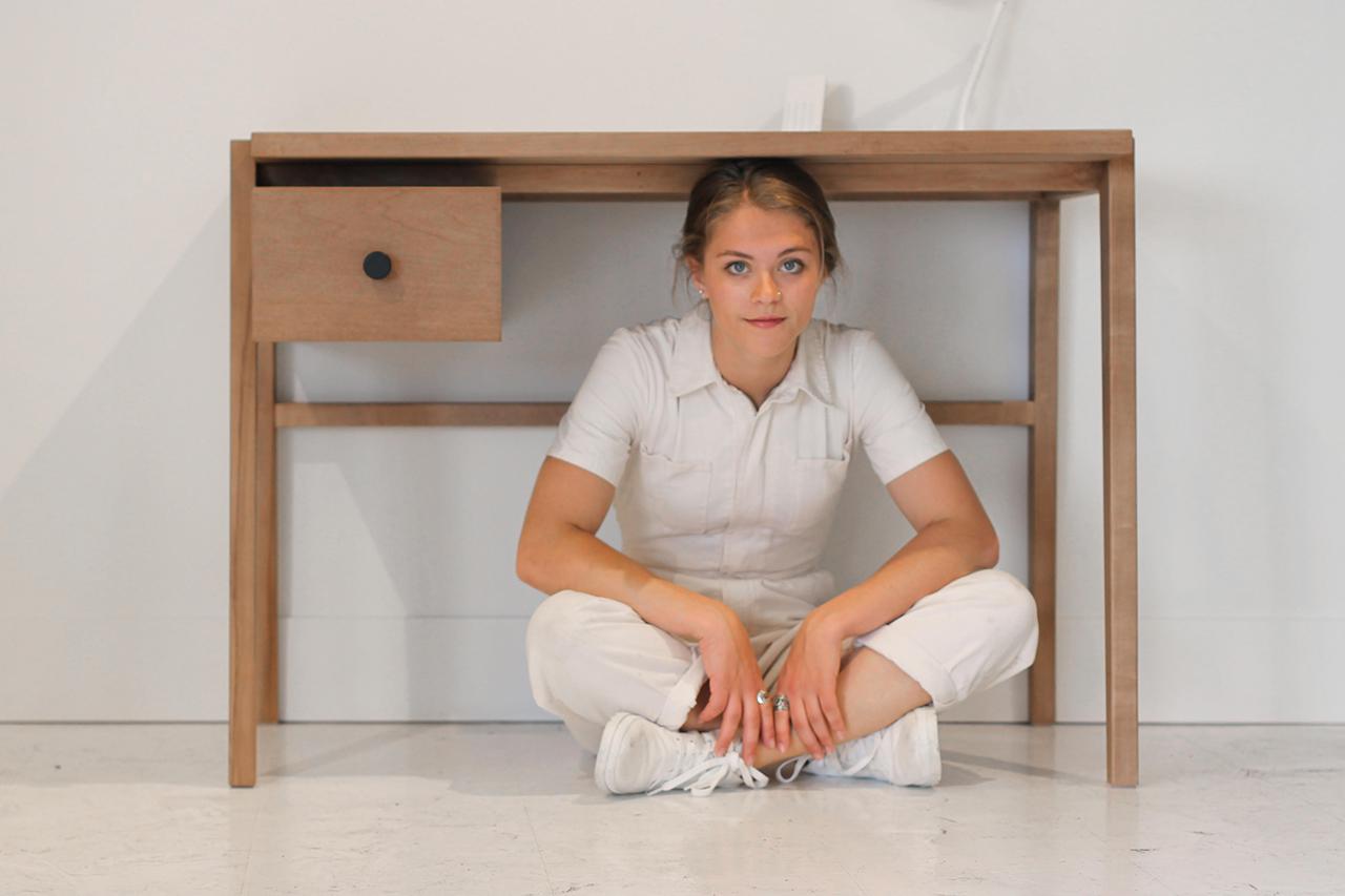 Maggie Jo sitting under desk