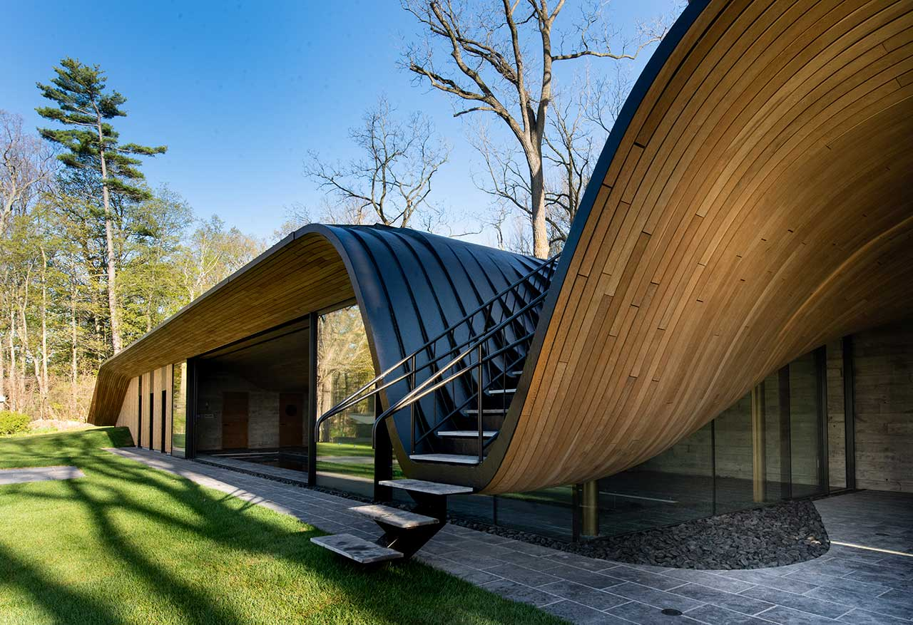 PARTISANS Designs a House That Folds into the Site's Topography