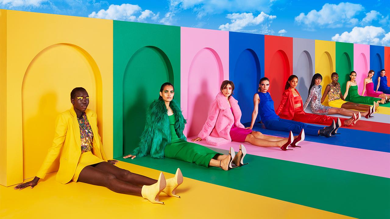models on rainbow background