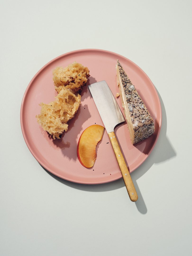 plate with knife and cheese