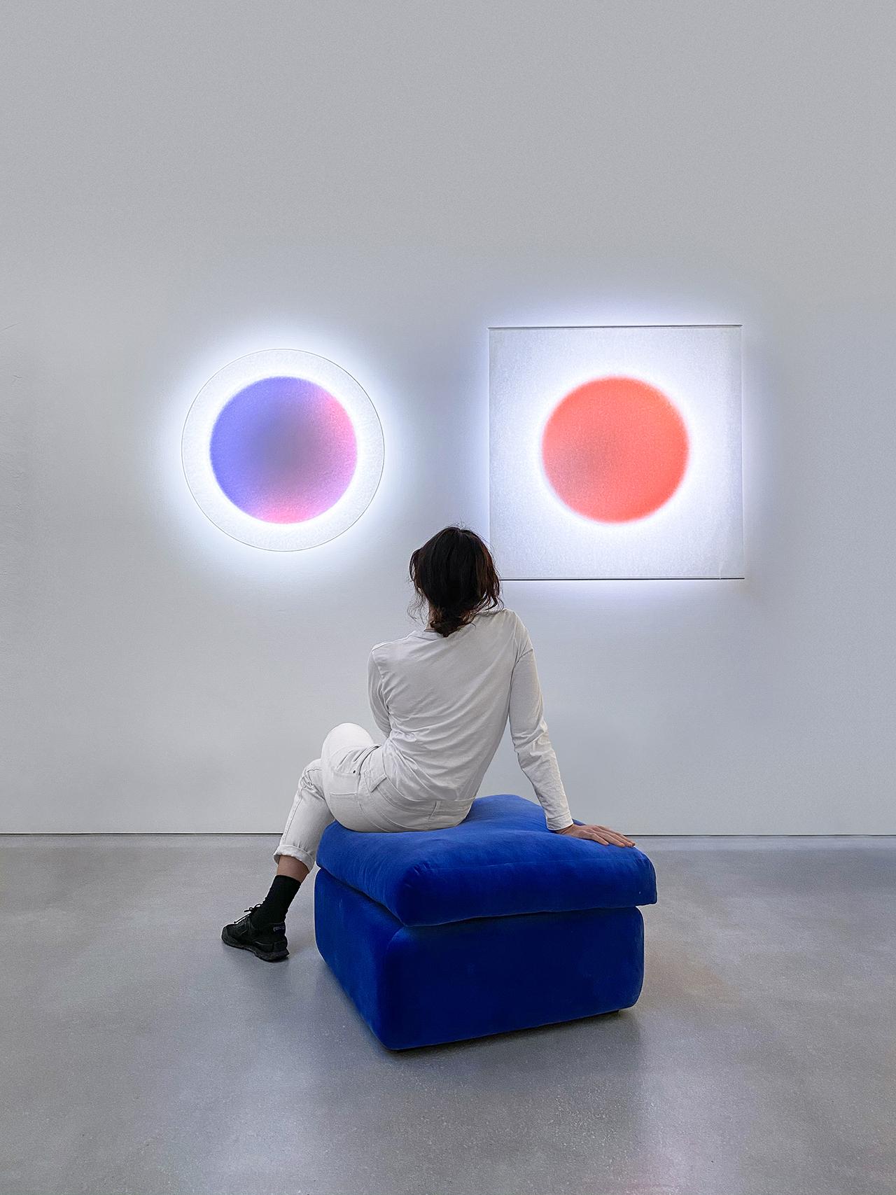 woman looking at wall lighting