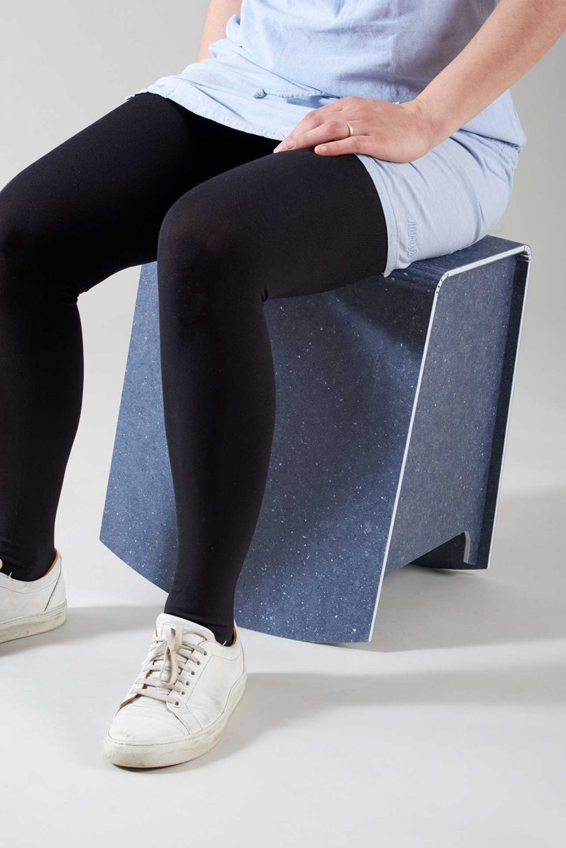 person sitting on rocking stool
