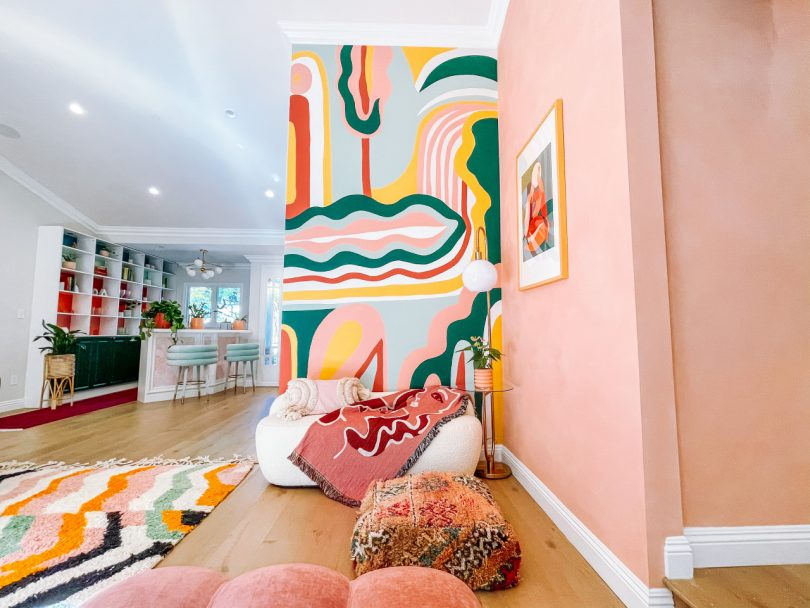 A Vibrant Living Room Redesign Stands Out With Custom Lime Wash Paint