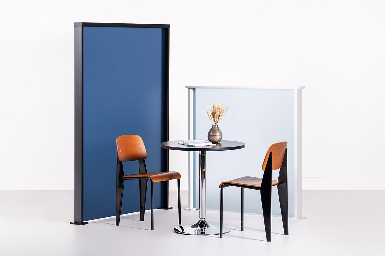 cafe table and chairs in front of colored screens