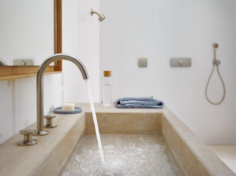 bathroom sink with water running