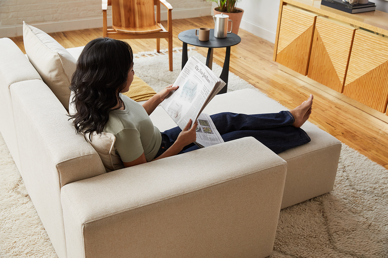 sectional sofa in living space with woman